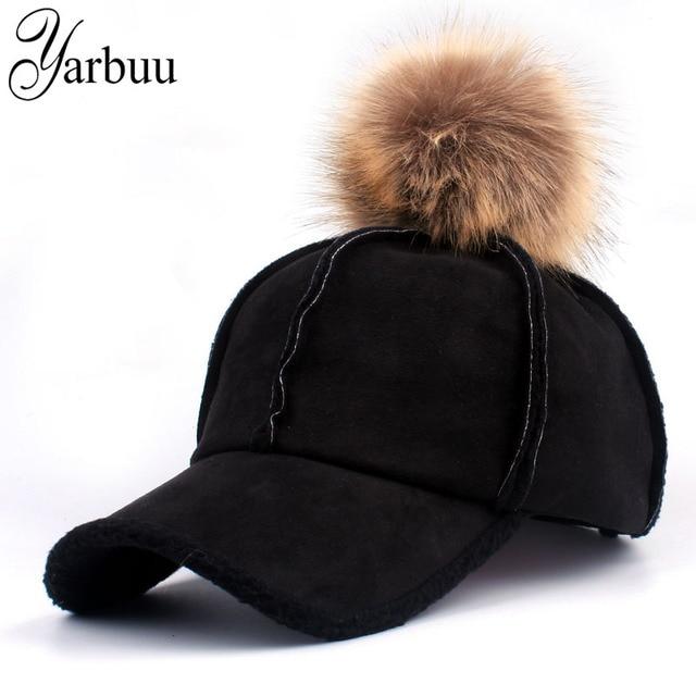 963723bd819  YARBUU  2018 good quality brand baseball caps winter cap for women Faux  Fur pompom ball Casual Snapback hat cap free shipping