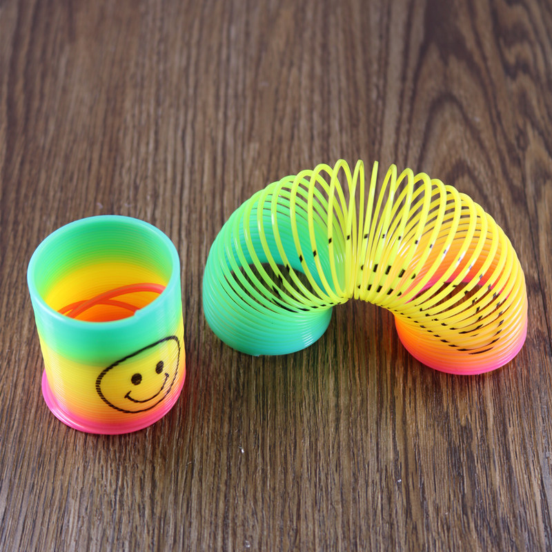 Cheap 12 Slinky Smiley Mini Springs Pinata Party Bag Fillers Wedding Kids Toy Prize Halloween Christmas holiday gifts недорго, оригинальная цена