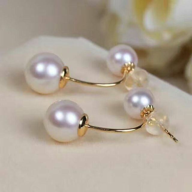 charming a pair of natural Akoya white pearl earrings yellow gold