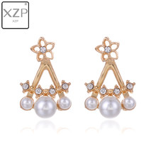 XZP Korean Jewelry Zircon Pearl Heart Crystal Flower Angel Wings Charm Geometry Stud Earrings For Women Statement Ear Jewelry(China)