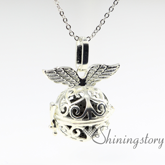 Wings openwork metal volcanic stone diffuser necklaces wholesale wings openwork metal volcanic stone diffuser necklaces wholesale essential oil diffuser necklace diffuser pendants aromatherapy in pendants from jewelry aloadofball Images