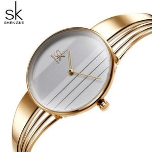 Image 1 - Shengke, relojes de pulsera lujosos de oro rosa para mujer, reloj de cuarzo creativo para mujer, reloj de pulsera para mujer 2019 SK # K0062