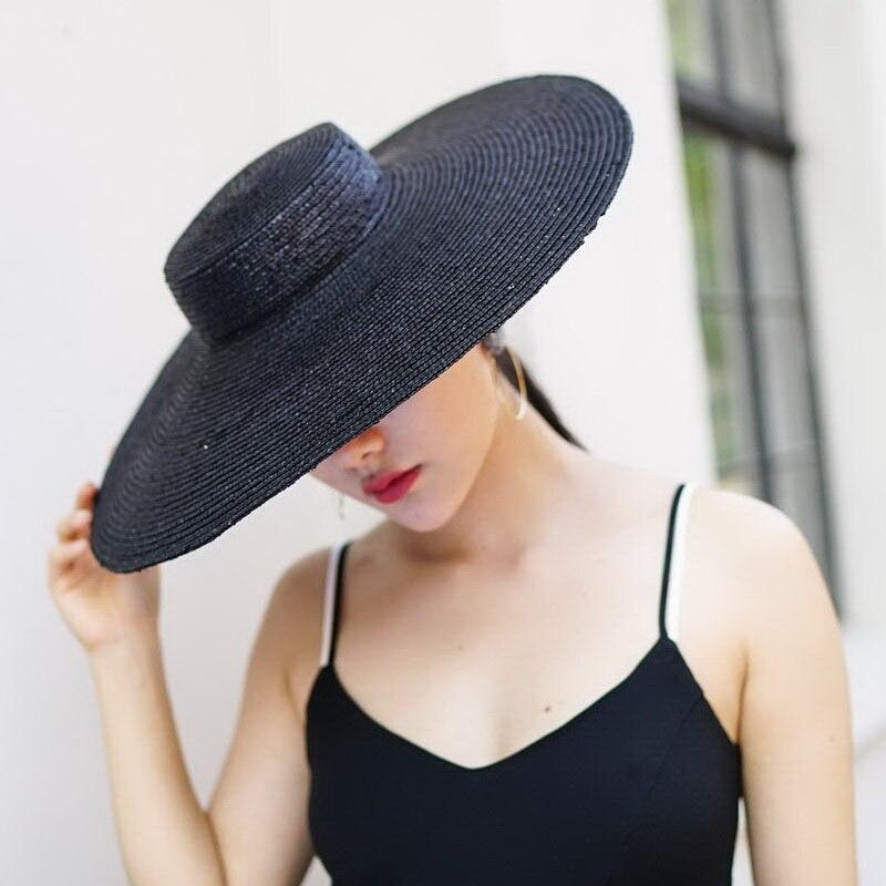 Cappello A Tesa larga Cappelli da Sole per Le Donne 2018 di Nuovo Modo Nero  Paglietta Cappello di Paglia Cappello Della Spiaggia per le Signore di Alta  ... 6a1a9a34f446