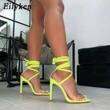 Eilyken 2020 ใหม่แฟชั่นเรืองแสงรองเท้าแตะข้อเท้าสายคล้องสายนาฬิกาผู้หญิงรองเท้าแตะ PVC 12.5CM รองเท้าส้นสูงรองเท้าแตะขนาด 43