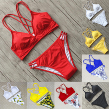 купить New Sexy Solid Color Bikini Women Swimsuit Floral Print Bathing Suit S-L Girl Backless Padded Swimwear Cross Micro Bikini Set по цене 658.64 рублей