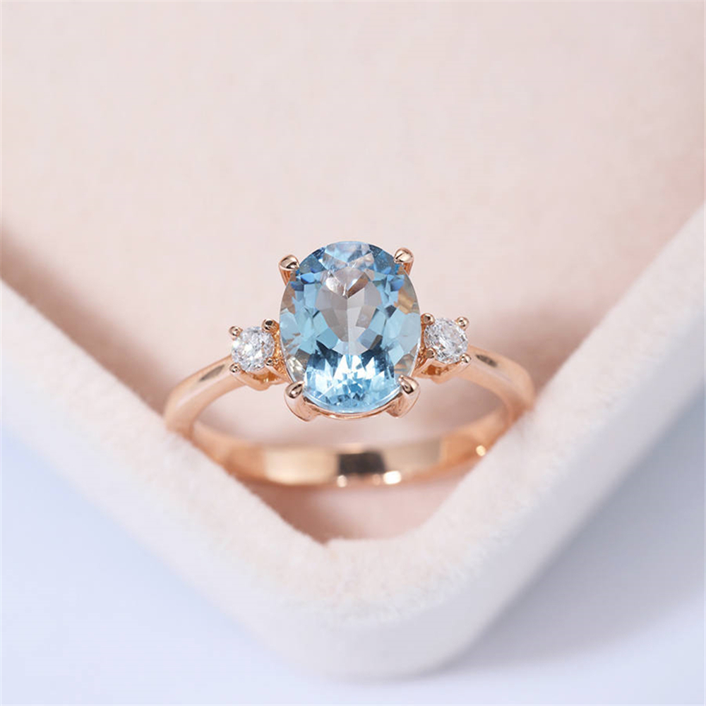 New stylish lady light luxury rose gold inlaid with natural sea blue zircon engagement ring.Suitable for party weddings.(China)