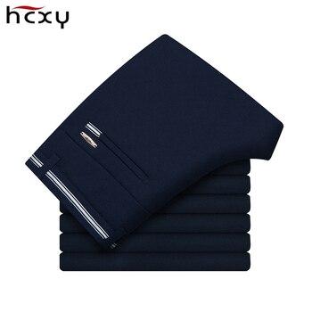 a503a70eff HCXY los hombres Pantalones de traje de ropa de trabajo Formal negro arruga  libre Pantalones Casual para Hombre azul de negocios Pantalones Hombre