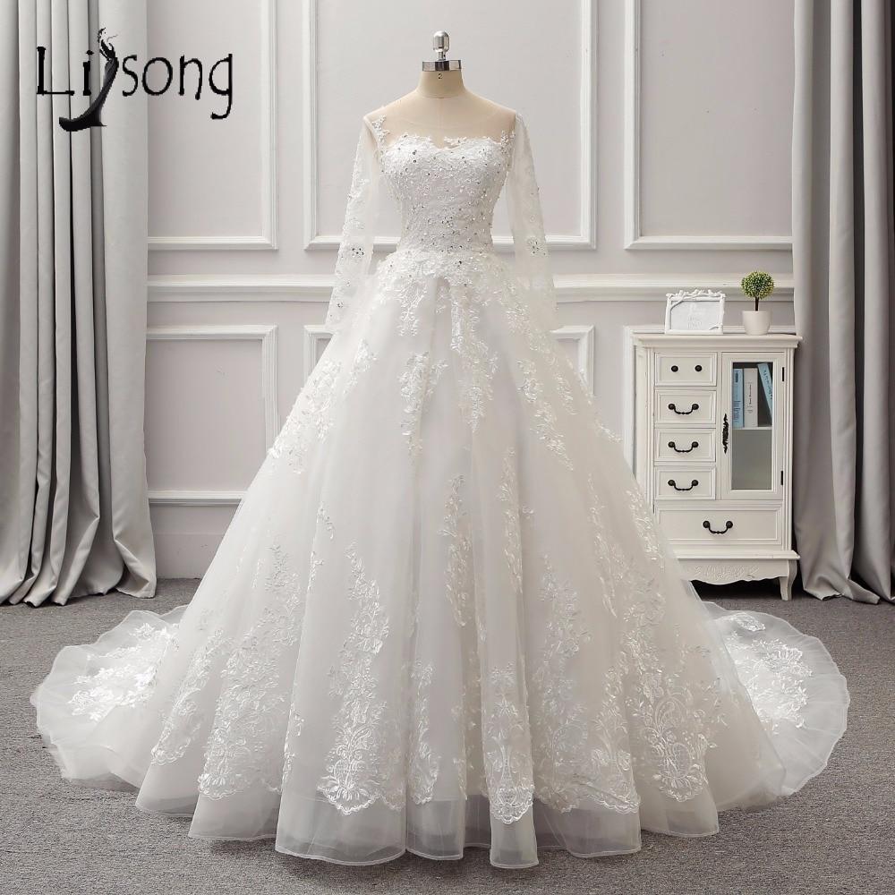 Magnifiques robes De mariée en dentelle à manches longues Sexy dos nu Empire robes De mariée Royal Train perles perlées dubaï Robe De Mariee