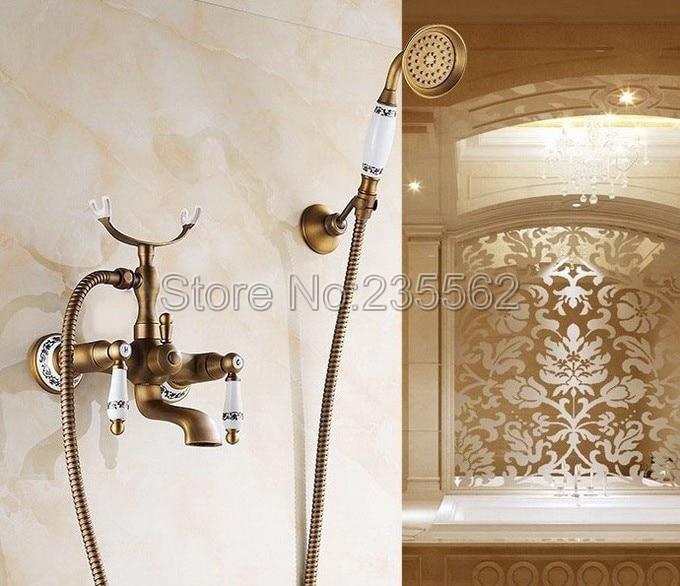 Antique Brass Porcelain Base Wall Mounted Bathroom Shower Faucet Dual Handle Bathtub Faucet with Handheld Shower Spray ltf308 bathtub faucet solid brass luxury floor standing bathroom bathtub faucet antique dual handle with handheld shower crane hj 6051