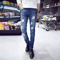 new spring 2016 men's fashion Slim Korean version of the trend of bleach hole jeans stretch straight solid color denim trousers
