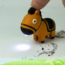 Cartoon cute zebra sound light glowing key chain LED flashlight creative gift factory direct wholesale