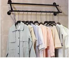 Clothes hangers. Display rack. Upper wall rack hang8001