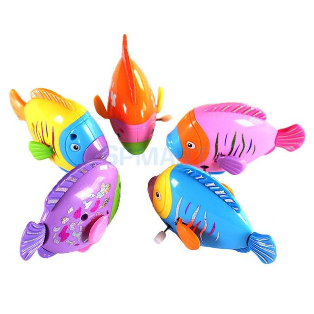 Mini rainbow coloured swing fish wind up toy for kids for Small plastic fish
