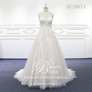Image 1 - 100% נדל תמונות מתוק לב חתונת שמלות משפט רכבת חתונה Vestido תחרת כלה שמלה עם אגלי XF18074