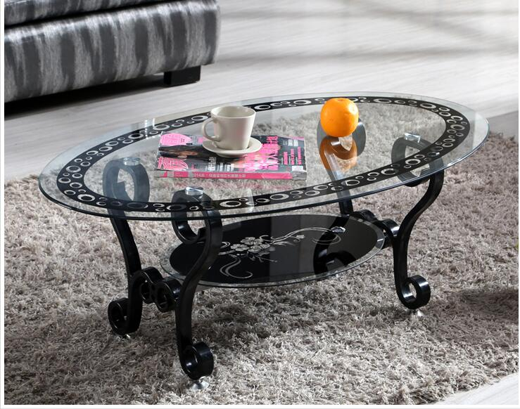 Modern living room double - tempered glass elliptic tea table..Modern living room double - tempered glass elliptic tea table..