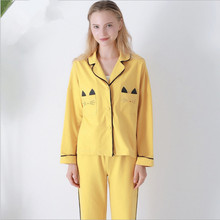 390f6d541dd3 New autumn winter women s pajama sets yellow color cute cat on pocket  European and American style