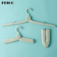 FEIGO Travel Folding Hanger Portable Drying Clothes Racks Dorm Room Magic Stretch Clothe Traveling Companion F365