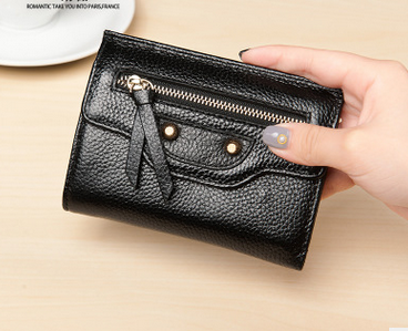 The new lady fashion short wallet two fold zero purse head cowhide ladies wallet