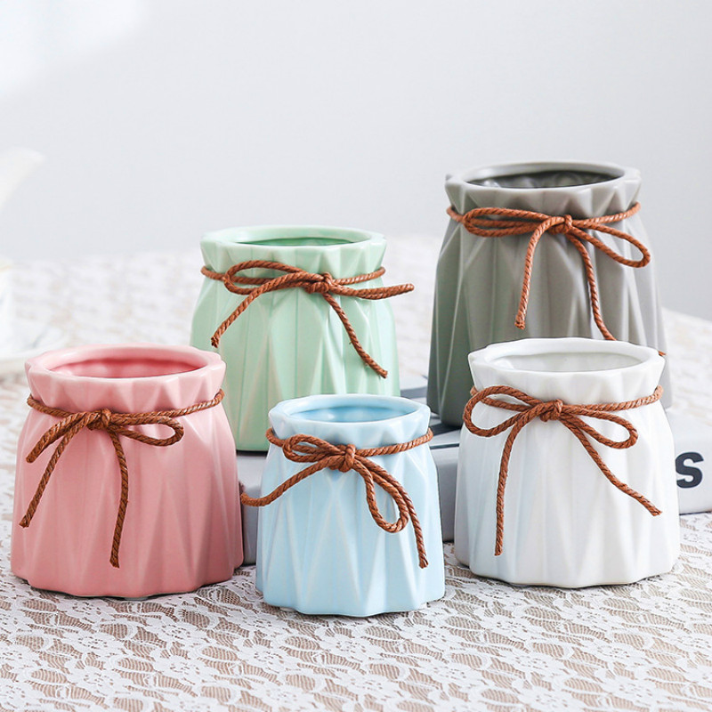 Two ways to make Newspaper Plant Pots • Lovely Greens | 300x300