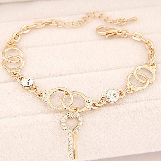 Yvlah An Alloy Gold Color Or Silver Bracelet With A Key Which Stand For