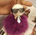 Moda Karl cara cristal Real de piel de zorro pom pom llavero Negro cartera de cuero Pompón muñeca monstruo carrito de golf bolsa colgante correa del encanto