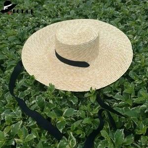 Image 1 - Venta al por mayor sombrero de paja de ala ancha mujeres gorro de playa de verano con lazo negro señoras nueva moda platillo sombrero de sol sombreros Kentucky Derby