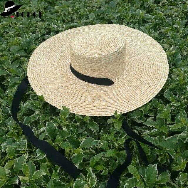 Venta al por mayor sombrero de paja de ala ancha mujeres gorro de playa de verano con lazo negro señoras nueva moda platillo sombrero de sol sombreros Kentucky Derby