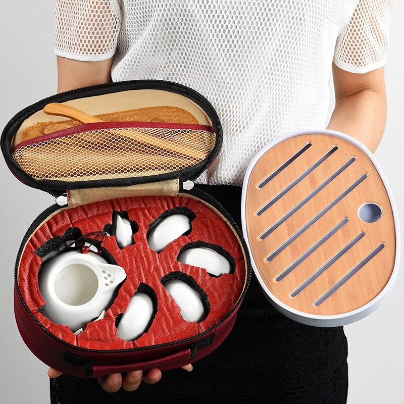 Ensemble de thé Kung Fu chinois en céramique avec quatre tasses de sacs portables Packs rapides théières de tasse en plein air