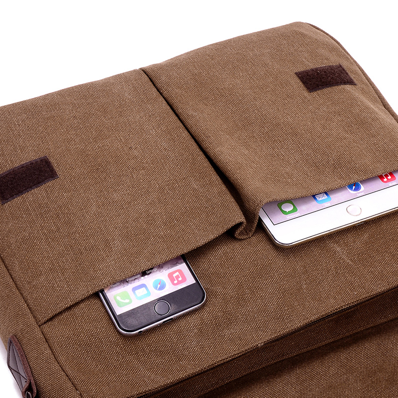 the mobile phone pocket of a canvas laptop bag