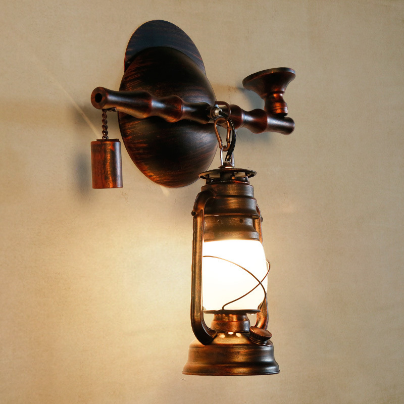 American retro loft restaurant wall lamp creative iron wall lamp teahouse bedroom aisle antique lamp kerosene wall lamp Cafe rh style popular in europe and the creative mall stores chain cafe cafe booth bronzing wrought iron wall lamp