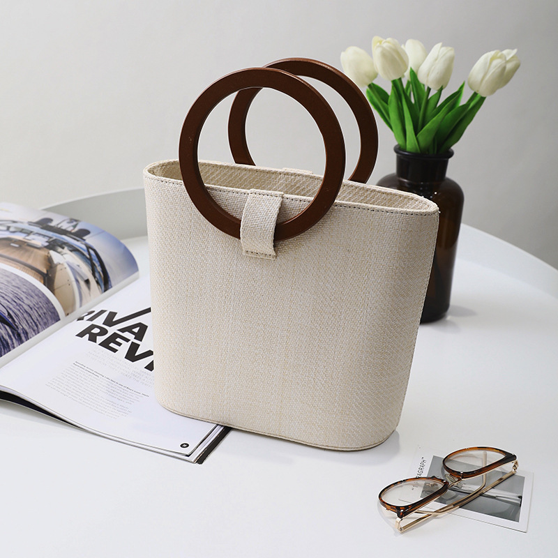 Straw woven lady bag 2018 new beach large bag woven solid wood handbag with one shoulder and one shoulder slanting in Shoulder Bags from Luggage Bags