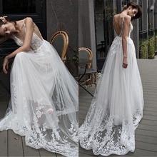 Fabulous טול עמוק V צוואר מחשוף אונליין חתונת שמלה עם תחרה אפליקציות & Beadings ארוך כלה שמלת שמלות 2019