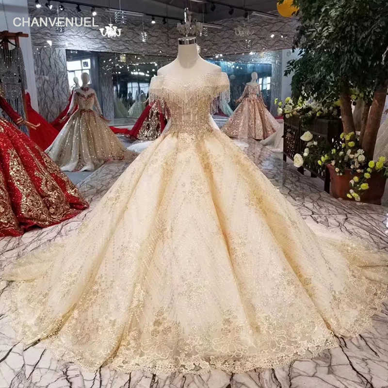 45dfe246964ad LS11250 dubai wedding dress with long train off shoulder tassel appliques  shiny wedding gown ball gown