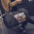 Новая Мода Дорожная Сумка Мужчин и Женщин Большие Сумки Большой Емкости Сумки Черный Знак Шаблон Багажные Сумки PT1130