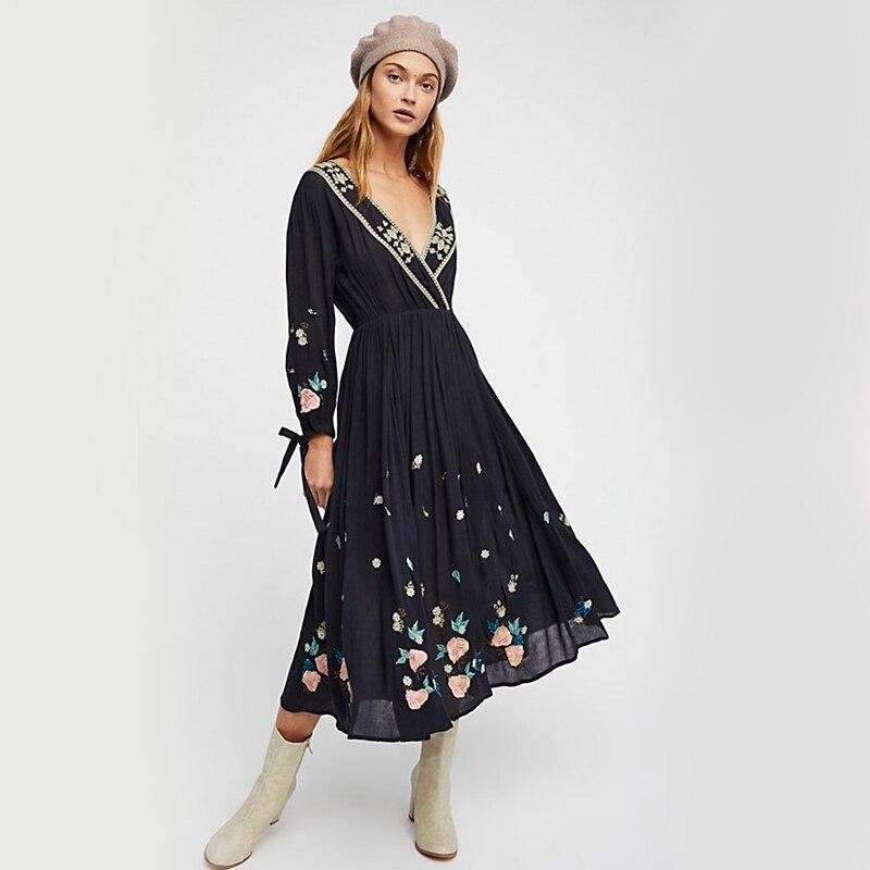 Nouveau fonds de voyage d'été tempête éthique sima broderie fleur V obtient l'appel sexuel pour fermer la taille pour montrer la robe mince