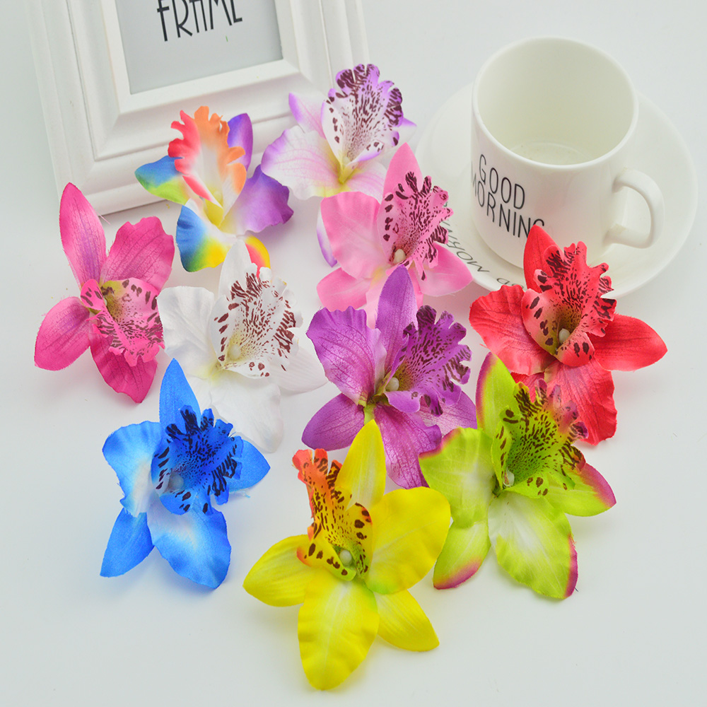 100pcs thai orchid cheap artificial flower for home wedding decora 100pcs thai orchid cheap artificial flower for home wedding decora diy silk phalaenopsis fake flower simulation butterfly orchid in artificial dried izmirmasajfo Image collections