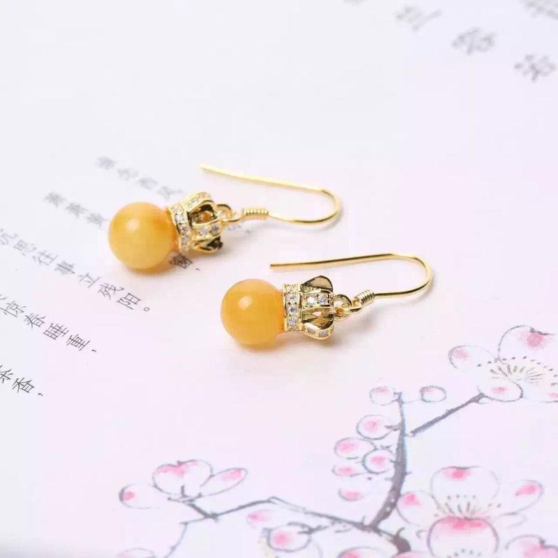 Veelkleurige sieraden oorbellen eenvoudige en elegante natuurlijke bijenwas groothandel een generatie