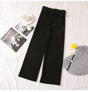 Image 2 - YuooMuoo lato elegancki styl regularne spodnie do kostek szerokie nogawki solidne plisowane spodnie wiosna wysokiej talii paski spodnie ściągane sznurkiem