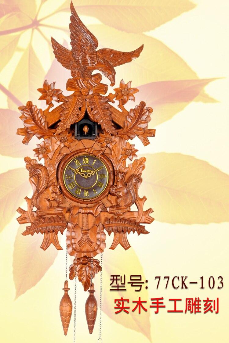 Coucou horloge coucou horloge pendule contrôle manuel gravure bois massif horloge européenne rétro salon montre
