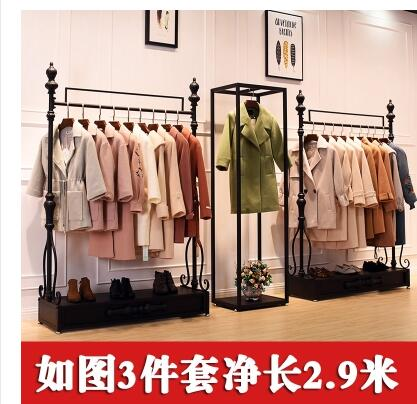 Retro clothing store display stand floor mounted men and women shop shelf display rack clothes rack .