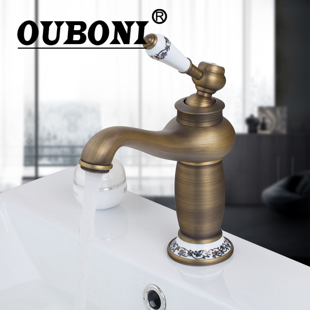 цена на OUBONI Antique Brass Bathroom Basin Faucet Vanity Sink Mixer Tap Deck Mounted Hot And Cold Water Mixer Tap