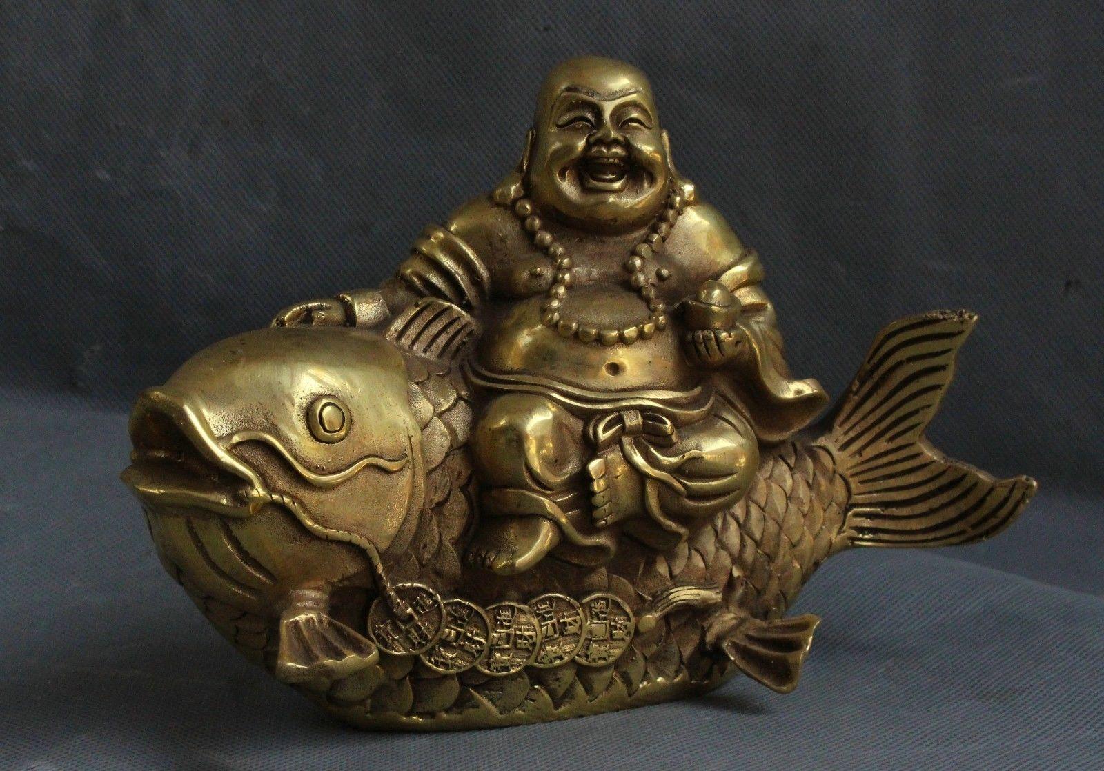 China Bronze Brass Yuan bao wealth Happy Laugh Maitreya Buddha Ride Fish StatueChina Bronze Brass Yuan bao wealth Happy Laugh Maitreya Buddha Ride Fish Statue