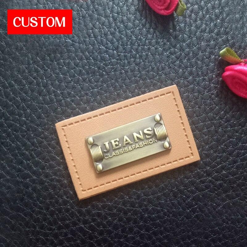 Logo en relief en cuir d'unité centrale en métal personnalisé par usine couture sur des vêtements imprimant des étiquettes de main en cuir faites main de mode d'impression