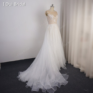 Image 2 - Cap Sleeve Sparkle Wedding Dress with Organza Ruffles Illusion Neckline Shinny Bridal Gown