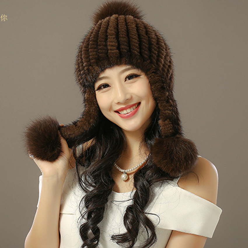 The new water mink fur fox fur ball Ms. ear hat female Korean autumn and winter thick warm foreign trade explosion models in europe and america in winter knit hat fashion warm mink mink hat lady ear cap dhy 36