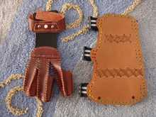 A Handmade archery gear set leather protective equipment refers to the three finger and Armguards
