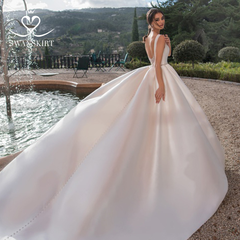 Image 3 - Swanskirt Luxury Satin Wedding Dress 2019 New Crystal Belt Backless A Line Princess Court Train Bride Gown Vestido de Noiva K167-in Wedding Dresses from Weddings & Events