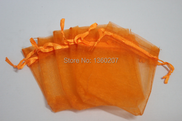 15f83e8fc 100 unids/lote 9x12 cm Orange regalo de boda del organza del color Bolsas  de tela