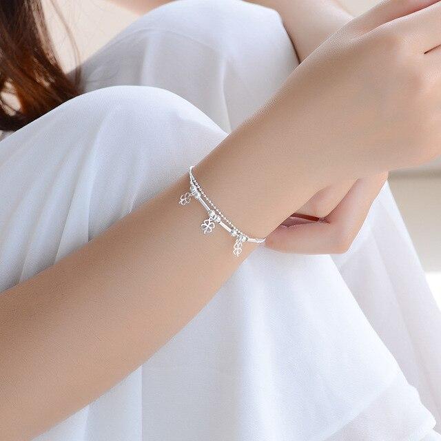 Красивые модные женские браслеты из ниток с бусинами в виде