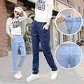 Новый Корейской версии большого размера джинсы женские жировые мм был тонкие женские джинсовые длинные брюки гарем брюки брюки поколения